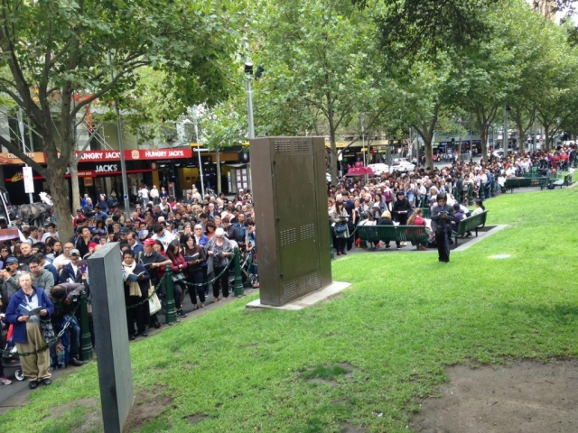 A view of the Way of the Cross 2016 crowd stretching along the Swanston Street footpath.