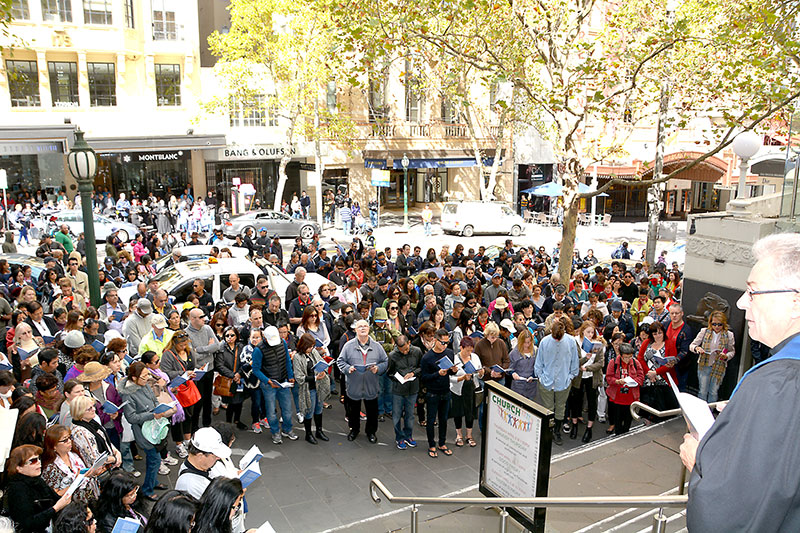 A portion of the crowd outside Collins Street Baptist Church from the top of the steps