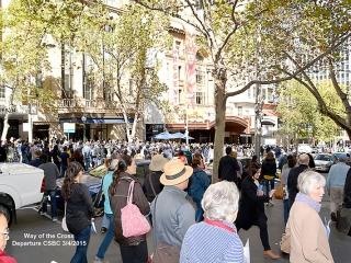 The crowd leaving Collins Street to walk to the final stations at St Pauls Cathedral Easter 2015