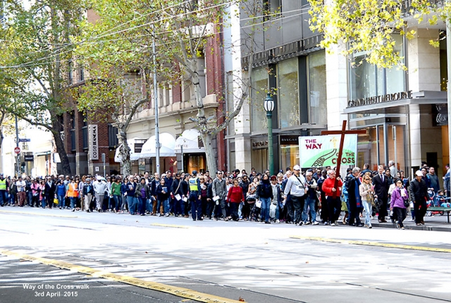 A large crowd walks past the Grand Hyatt Melbourne along Collins Street for The Way of the Cross Easter 2015